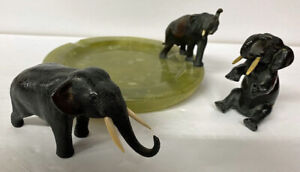 MINATURE CAST IRON ELEPHANTS  WITH REAL IVOTY TUSKS  ASSH TRAY SET