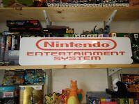 "NES Display (White), Nintendo Entertainment System, Aluminum Sign, 6"" x 24""."