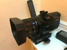 Sony FDR-AX100 4K Camera with Latest Updates and Custom Handle + SD Car