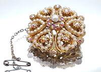 Vintage Aurora Borealis faux pearl brooch.