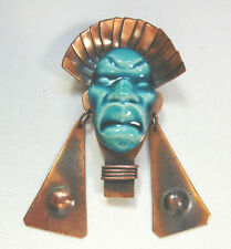Green glazed ceramic and copper face pin