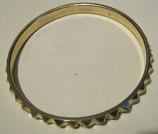 Gorgeous gold tone metal bangle style bracelet with pyramid decoration