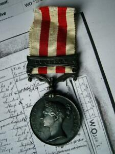 HEIC Victorian Indian Mutiny Lucknow medal J Tullet 1st Madras Fusiliers 1857