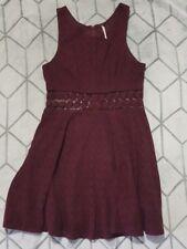 FREE PEOPLE crocheted mini flare dress. peekaboo waist. maroon. size 2.