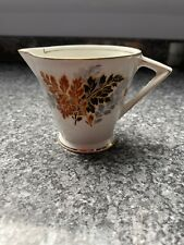 Palissy Autuninal Shade Of Orange Milk Jug And Tea Cup