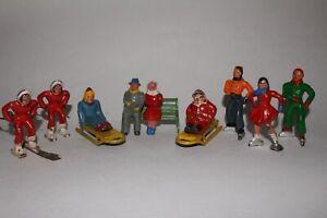LOT OF 12 BARCLAY VINTAGE LEAD FIGURES SKATERS AND SLEDDING SANTA LOT #23