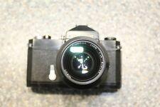 Nikkormat FT SLR camera + Nikon Nikkor 35mm 1:1.4 lens