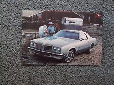 1977 olds cutlas silver green 2dr postcard