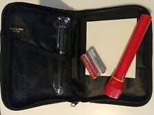 Travel case with flashlight and pen