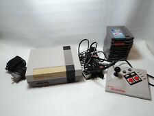 Nintendo NES Console with Gun, 2 Controllers, 10 Game Lot & Advantage Joystick