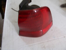 1996 1997  TBIRD FORD THUNDERBIRD RIGHT TAILLIGHT USED OEM  RED TRIM BRAKE TURN