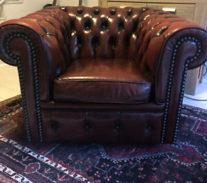 Vintage Moran leather and stud chesterfield armchair
