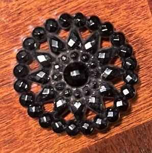 Large black glass button with open work antique loop and plate shank.