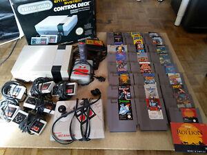 Console Nintendo NES + boîte + Jeux + Accessoires - Ne fonctionne pas