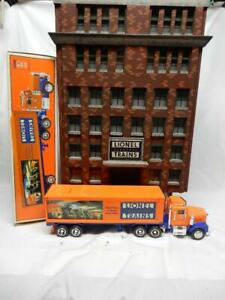LIONEL 6 STORY OFFICE BUILDING WITH LIONEL TMT- 18011 TRACTOR TRAILER  TRUCK