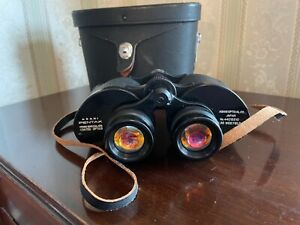 Asahi Pentax prism coated binoculars 7x35 Wide Field 11 degree with case.