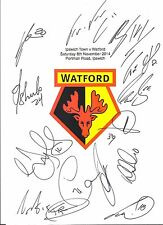 An A4 white card with the Watford Badge. Signed by 13 players on 08.11.14.