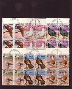 BIRDS on Stamps....  Nicaragua  1985 bird set in used blocks of 4