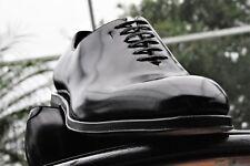 FERRAGAMO Mens LAVORAZIONE TRAMEZZA Black one piece  leather Dress shoe 9.5EE