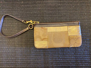 """Coach Signature """"C"""" Gold And brown  Canvas Wristlet"""