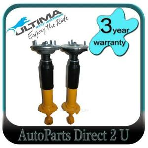 New Front Pair Ultima Strut Shock Absorbers Nissan Navara D23 D40 2005-2015