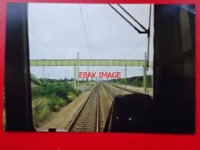PHOTO  VIEW FROM CAB ON THE PETERBOROUGH TO SPALDING LINE 20/8/90