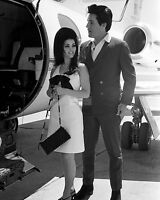 ELVIS PRESLEY & PRISCILLA IN LAS VEGAS BOARDING PLANE 1967 - 8X10 PHOTO (EE-064)