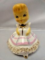 Vintage Japan Shopping Girl Bell with Gift Spaghetti Mica Gold Trim Figurine