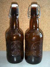"TWO VINTAGE GROLSCH BEER BROWN BOTTLE W/ WIRE BALE & CERAMIC STOPPER, 9 1/2"" T"