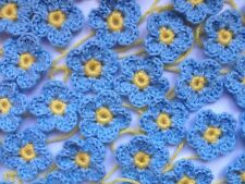 20 Crochet Flowers with cornflower blue petals and yellow centres - 4cm