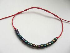 KARMASTRING tie on string bracelet anklet with 19 iris beads karma ecliptic