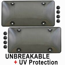 2 Tinted Smoke UNBREAKABLE License Plate Shield Covers + 8 Black Screw Caps NEW