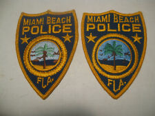 MIAMI BEACH FLORIDA PAIR OF 2 DIFFERENT POLICE PATCHES (DIFFERENT CENTERS)