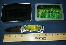 Decorative Pocket Knife with Deer on it, includes storage tin