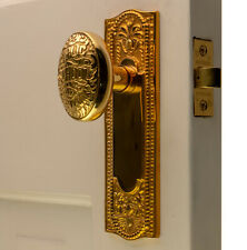 The Orlean Passage Set in Polished Brass with New York Door Knobs