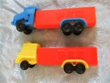 TWO VINTAGE PEZ TRUCK DISPENSERS NO FEET-YELLOW/BLUE CAB MADE IN SLOVENIA