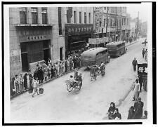 Chongqing commercial street,people waiting to board buses,rickshaws,walking,1944