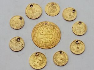 Lot of old Ottoman coins from different years gold coloured