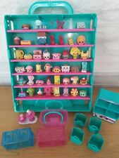 Shopkins collector's case and figures