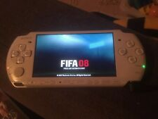 sony psp console including charger and 5 games