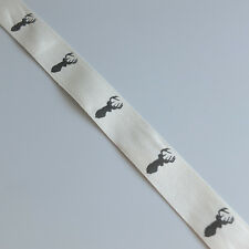 2m of cream woven soft ribbon with brown stag head silhouette print - 25mm wide
