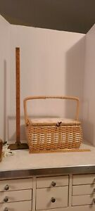 Vintage woven sewing basket with butterflies. Pin cushion on interior lid.