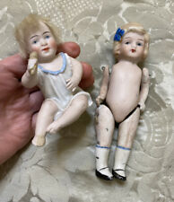 Two Antique All Bisque Dolls In Need Of Repair Sitting Baby With Rattle And Girl