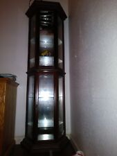 Brown corner china cabinet with glass shelves and light. ExcelEnt condition.