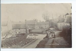 Real photo postcard of some children in Askerswell Dorset in good condition