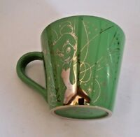 Tinkerbelle green coffee mug with gold graphic Disney