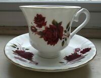 Vintage Fine Bone China.Deep Red Roses on white.Tea Cup/Saucer Made In England.