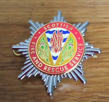 An old  Scottish Fire & Rescue Service, cap badge.