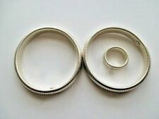 bracelets and 1 matching ring 2 vintage sterling stretch cuff