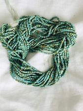 "Turquoise Like Tiny Heishi Beads. Single 15"" strand."